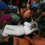 An asylum seeker survivor is carried off an Indonesian rescue boat at Merak seaport on August 31, 2012. Afghans were among the 54 survivors from an asylum seeker boat that disappeared two days ago off the Indonesian coast. (AFP Photo/Bay Ismoyo)