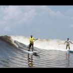 Video: 2 Guys SUP Indonesian Tidal Bore