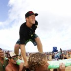 Sebastian Zietz (HAW), 24, surfs up the beach following his clinching of the 2012 Vans Hawaiian Triple Crown of Surfing. Photo © ASP/ Dunbar.