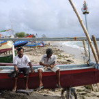 Day off: Two Kedonganan fishermen sit on their traditional outrigger enjoying a day off after heavy winds and high waves prevented them from setting sail. BD/Agung Parameswara
