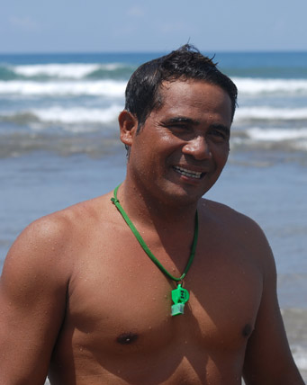 Smile: Nyoman Wirnaya smiles after he rescues a visitor in Kuta. Pic: BD/Chris O'Connor