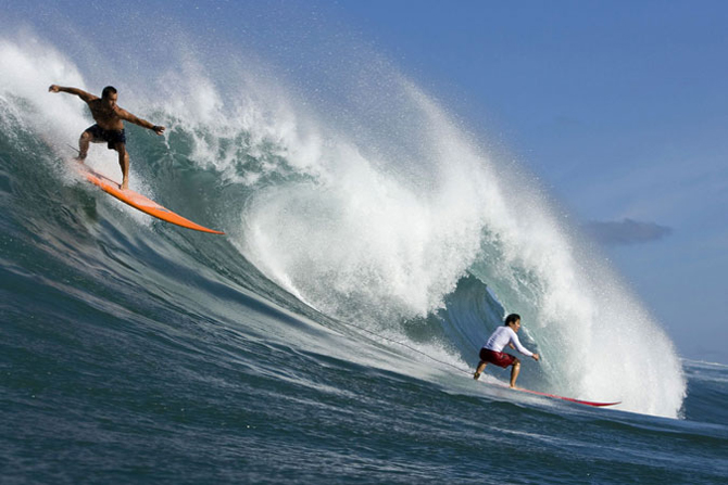 Surfers in Hawaii Photo: Reuters.