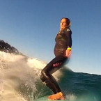 Woman surfs into her nine months of pregnancy