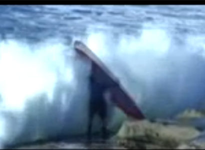 Video: Horrible timing for the surfer