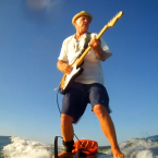 Video: Man Plays Electric Guitar Through Amp While Surf