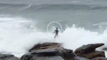 Video: Surfer's Failed Rock Jump