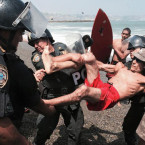 Surfers at Peruvian Beach Clash With Riot Police