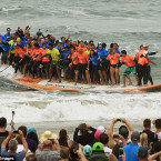 66 Surfers Set Record for Most People Riding a Board at Once