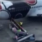 Baggage Handlers Caught on Video Throwing Surfboards