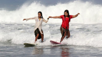 Women in Kebaya Surfs Kuta Beach to Commemorate Kartini Day