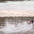 Skimboarder Ride Tidal Bore Wave in The Dordogne River, France